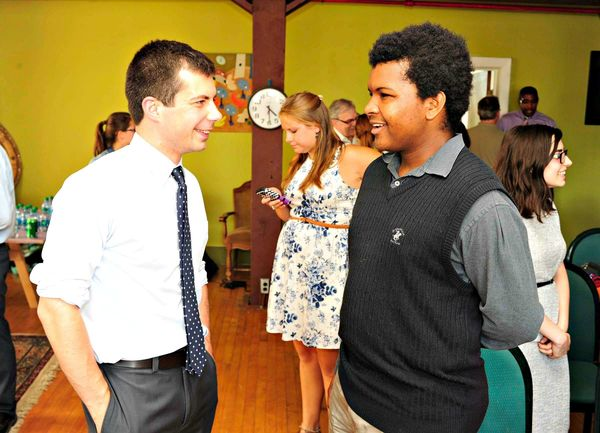 South Bend Mayor Pete Buttigieg and Bowman Creek Project intern Shaquille Johnson, a Notre Dame student, discuss Bowman Creek